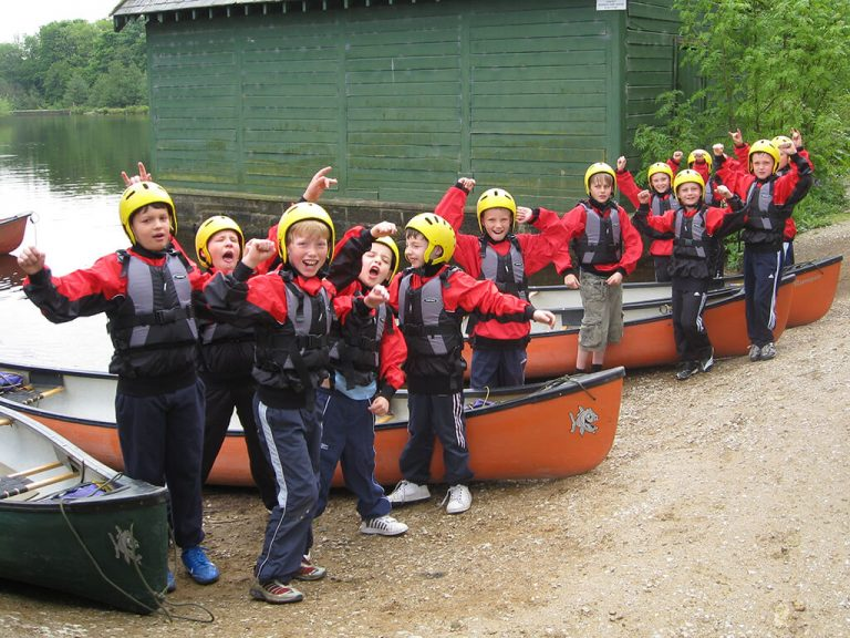 Goup of kids ready to kayak