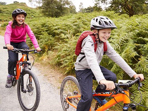 Children mountain biking
