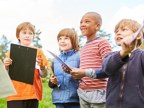 Children taking part in a scavenger hunt